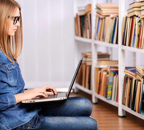 Girl on laptop searching for video resources
